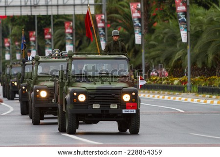 ISTANBUL, TURKEY - AUGUST 30, 2014: Soldiers in vehicles during 92th anniversary of 30 August Turkish Victory Day parade on Vatan Avenue