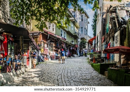 ISTANBUL, TURKEY, AUGUST 22, 2014: Street of the Cold Fountain or Sogukcesme Sokagi is a small street with historic houses in the Sultanahmet neighborhood of Istanbul - stock photo