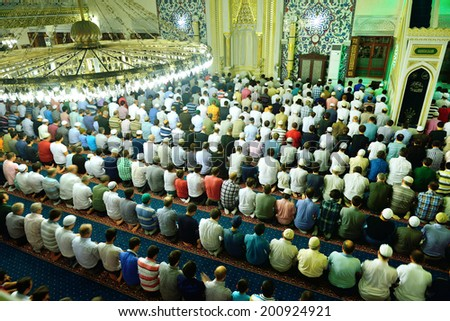 ISTANBUL, TURKEY - AUGUST 03: Tarawih prayers in Ramadan for Muslims Tunahan Mosque on August 3, 2013 in Istanbul, Turkey. Tunahan mosque, is a big mosque was opened for worship in 2004. - stock photo