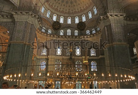 ISTANBUL, TURKEY - AUGUST 08, 2015: The interior of the New Mosque (Yeni Cami).  The New Mosque is an Ottoman imperial mosque completed in 1665, located on the Golden Horn in Istanbul, Turkey.  - stock photo