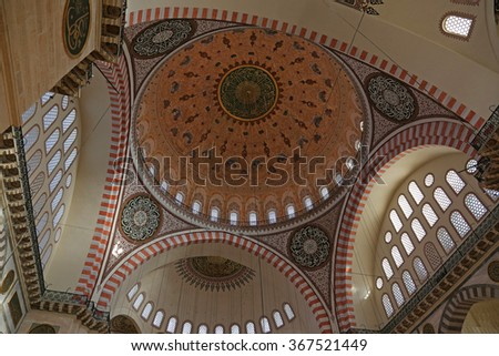 ISTANBUL, TURKEY - AUGUST 14, 2015: The interior of the Suleymaniye mosque.  It is an Ottoman mosque completed in 1558.  - stock photo