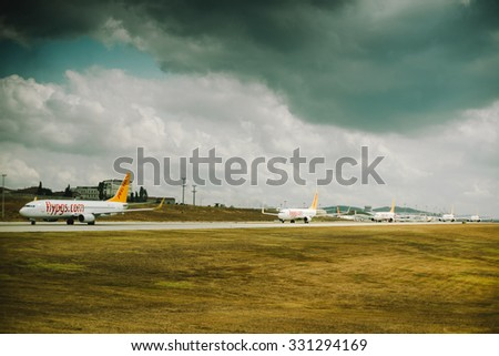 Istanbul, Turkey - August 3, 2015: The line of aircraft for takeoff at the airport Sabiha Gokcen Airport in Istanbul runway 2015 - stock photo