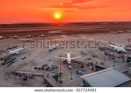 Istanbul, Turkey, August 18, 2015: Turkish Airlines Airplanes Boarding at Istanbul Ataturk Airport During Sunset