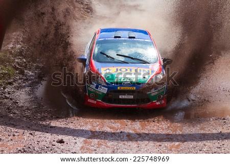 ISTANBUL, TURKEY - AUGUST 17, 2014: Umit Can drives Ford Fiesta R2 car of Castrol Ford Team Turkiye in Avis Bosphorus Rally, Gocbeyli Stage - stock photo