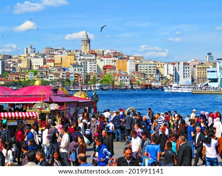 ISTANBUL, TURKEY -- CIRCA APRIL 2014: Berth Eminonu. View on Karakoy and Galata Tower - stock photo