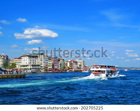ISTANBUL, TURKEY -- CIRCA APRIL 2014:  The ferry sails along the New houses on the banks of the Bosphorus - stock photo