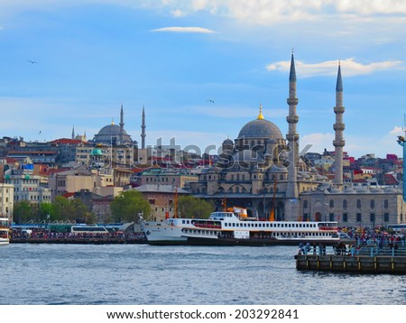 ISTANBUL, TURKEY -- CIRCA APRIL 2014: View of the New Mosque  and embankment from the Galata Bridge - stock photo