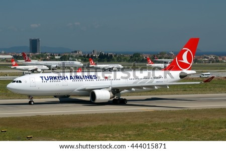 ISTANBUL, TURKEY - CIRCA MAY, 2015: Turkish Airlines Airbus A330 jet passenger aircraft liniing up runway with Boeing-777 Airbus A320 Airbus A321 of Turkish Airlines holding short on taxiway - stock photo