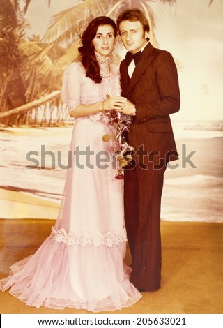 ISTANBUL, TURKEY, CIRCA 1970s:  A vintage photo of a young couple on their wedding day.Istanbul, Turkey, circa 1970s. - stock photo