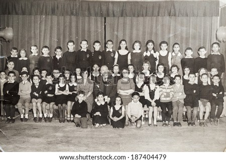 ISTANBUL-Turkey,Circa 1950's :An antique photo shows group portrait of school graduates.  - stock photo