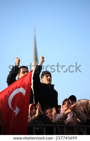 ISTANBUL,TURKEY-DEC 14:Turkish police raid Zaman building, attempt to detain editor. A crowd of protesters forced police to turn back before they could make arrests on Dec 14, 2014 in Istanbul,Turkey. - stock photo