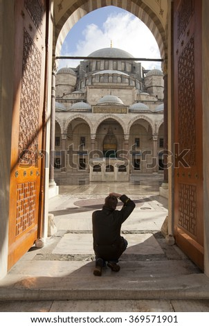 ISTANBUL,TURKEY - DEC 30 : Unidentified man taking photo at Suleymaniye Mosque on Dec 30,2015 in Istanbul,Turkey. The Suleymaniye Mosque is the largest & one of the best-known mosque of Istanbul.
