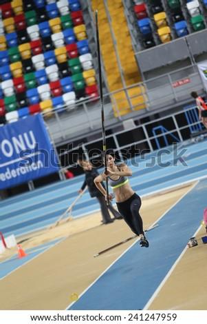 ISTANBUL, TURKEY - DECEMBER 27, 2014: Athlete Buse Arikazan pole vaulting during Athletics record attempt races in Asli Cakir Alptekin Athletics hall, Istanbul. - stock photo