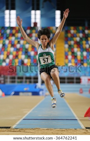 ISTANBUL, TURKEY - DECEMBER 12, 2015: Athlete Buse Iskender long jumpes during Turkish Athletic Federation Olympic Threshold Indoor Competitions