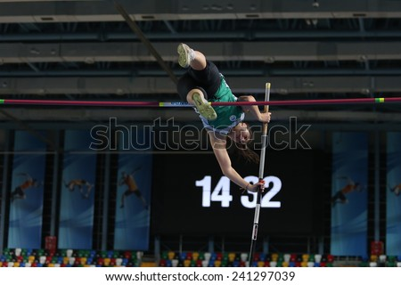 ISTANBUL, TURKEY - DECEMBER 27, 2014: Athlete Hilal Kalkan pole vaulting during Athletics record attempt races in Asli Cakir Alptekin Athletics hall, Istanbul. - stock photo