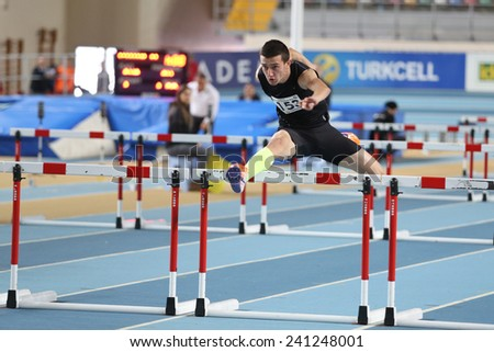 ISTANBUL, TURKEY - DECEMBER 28, 2014: Athlete Kerem Colak Steeplechase running during Athletics record attempt races in Asli Cakir Alptekin Athletics hall, Istanbul. - stock photo