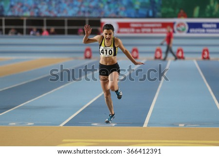 ISTANBUL, TURKEY - DECEMBER 26, 2015: Athlete Melike Malkoc 60 metres race during Turkish Athletic Federation Indoor Athletics Record Attempt Races - stock photo