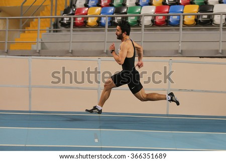 ISTANBUL, TURKEY - DECEMBER 26, 2015: Athlete Miktat Kaya runs during Turkish Athletic Federation Indoor Athletics Record Attempt Races