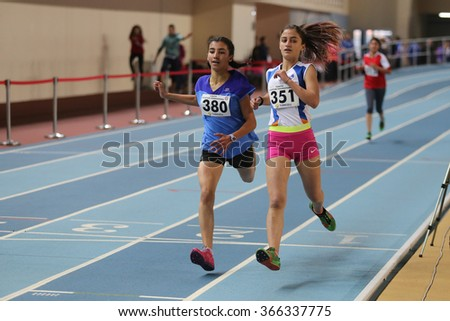 ISTANBUL, TURKEY - DECEMBER 26, 2015: Athletes run during Turkish Athletic Federation Indoor Athletics Record Attempt Races