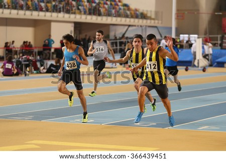 ISTANBUL, TURKEY - DECEMBER 26, 2015: Athletes run 60 metres race during Turkish Athletic Federation Indoor Athletics Record Attempt Races