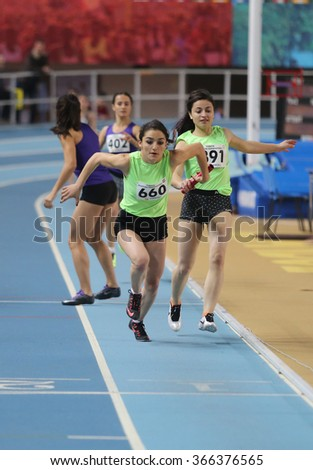 ISTANBUL, TURKEY - DECEMBER 26, 2015: Athletes run 4x400 relay race during Turkish Athletic Federation Indoor Athletics Record Attempt Races