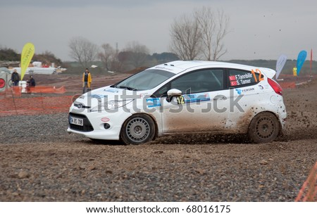 ISTANBUL, TURKEY - DECEMBER 26: Ferhat Tanribilir drives a  Ford Fiesta R2 car during Istanbul Rally Championship, SS Stage on December 26, 2010 in Istanbul, Turkey - stock photo
