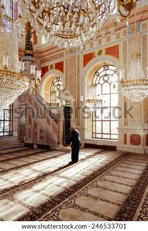 ISTANBUL, TURKEY - DECEMBER 23: Ortakoy Mosque interior.Muslim men praying in a ortakoy mosque inside in Istanbul. DECEMBER 23, 2015 in Istanbul, Turkey .  - stock photo
