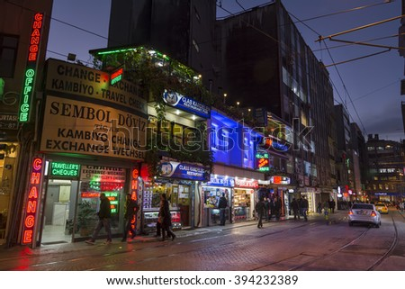 ISTANBUL, TURKEY, DECEMBER 12, 2013: Street with several illuminated billboards at Sirkeci, a quarter in the Eminonu neighborhood of the Fatih district of Istanbul city.