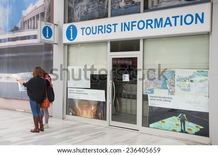 ISTANBUL, TURKEY - December 6: Tourist information office in Istanbul. Tourists looking at the map of Istanbul. December 6, 2014 in Istanbul, Turkey. - stock photo