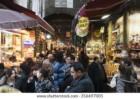 ISTANBUL,TURKEY, DECEMBER 23,2015:Tourists visiting Egyptian Bazaar on  DECEMBER 23,2015 in istanbul,Turkey.Located in Eminonu District is the second largest covered shopping complex after GrandBazaar - stock photo