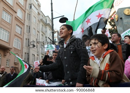 ISTANBUL,TURKEY-DECEMBER 2: Unidentified Syrians living in Istanbul protest the regime of Bashar Essad in front of Syrian Consulate on December 2, 2011 in Istanbul, Turkey. - stock photo