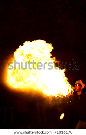 ISTANBUL, TURKEY - FEBRUARY 19: A Fire juggler performs during street shows in Galata square on February 19, 2011 in Istanbul, Turkey. Galata square is an important show place for jugglers in Istanbul