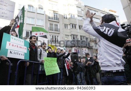 ISTANBUL, TURKEY-FEBRUARY 5: A group of people have staged a demonstration in front of the Syrian Consulate, protesting Syrian authorities' violent crackdown in Homs, on Feb 5, 2012 in Istanbul, Turkey - stock photo