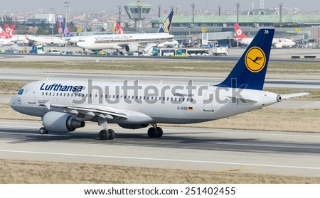 ISTANBUL , TURKEY - FEBRUARY 9, 2015: Aircraft of Luftansa, is making taxi at Istanbul Ataturk International Airport on February 9, 2015 . Aircraft is an Airbus 320-200 - stock photo