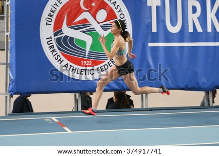 ISTANBUL, TURKEY - FEBRUARY 06, 2016: An Athlete running 400 meters during Turkish Athletic Federation Clubs Indoor Championship - stock photo