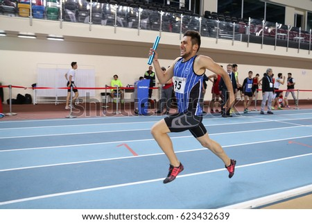 ISTANBUL, TURKEY - FEBRUARY 05, 2017: Athlete Atakan Altunsoy running 4x400 metres during Turkcell Turkish Youth Indoor Championships