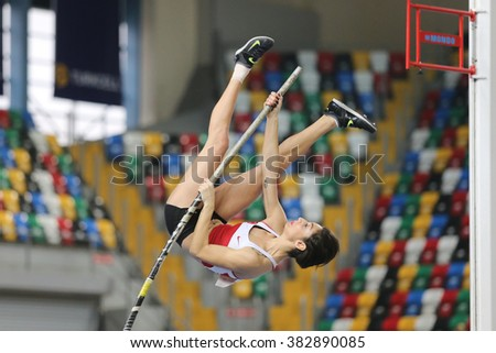 ISTANBUL, TURKEY - FEBRUARY 27, 2016: Athlete Buse Arikazan pole vaulting in Balkan Athletics Indoor Championships - stock photo