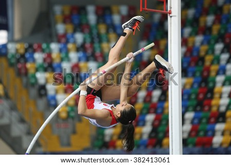 ISTANBUL, TURKEY - FEBRUARY 25, 2016: Athlete Demet Parlak pole vaulting in Athletics Istanbul Indoor Championships - stock photo