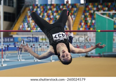 ISTANBUL, TURKEY - FEBRUARY 15, 2015: Athlete Esmanur Alkac high jump during Turkcell Juniors and Seniors Athletics Turkey Indoor Championship in Asli Cakir Alptekin Athletics hall - stock photo