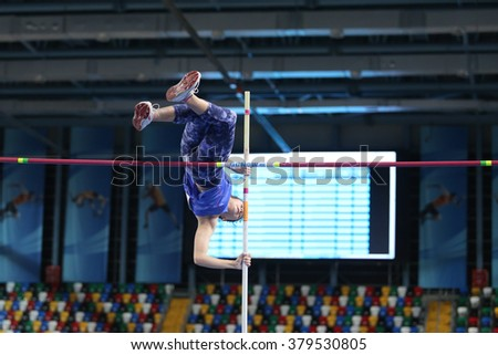 ISTANBUL, TURKEY - FEBRUARY 20, 2016: Athlete Hatice Nur Aydogdu pole vaulting during Turkcell Turkish Indoor Athletics Championships - stock photo