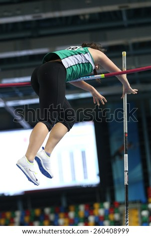 ISTANBUL, TURKEY - FEBRUARY 14, 2015: Athlete Hilal Kalkan pole vaulting during Turkcell Juniors and Seniors Athletics Turkey Indoor Championship in Asli Cakir Alptekin Athletics hall - stock photo