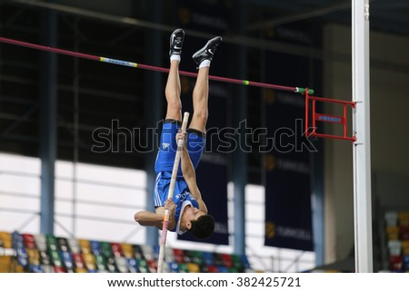 ISTANBUL, TURKEY - FEBRUARY 25, 2016: Athlete Nilolaos Nerantzis pole vaulting in Athletics Istanbul Indoor Championships - stock photo
