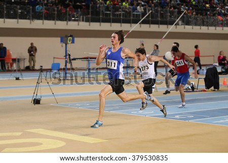 ISTANBUL, TURKEY - FEBRUARY 20, 2016: Athletes running 60 meters during Turkcell Turkish Indoor Athletics Championships - stock photo