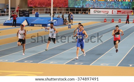 ISTANBUL, TURKEY - FEBRUARY 06, 2016: Athletes running 60 meters during Turkish Athletic Federation Clubs Indoor Championship - stock photo