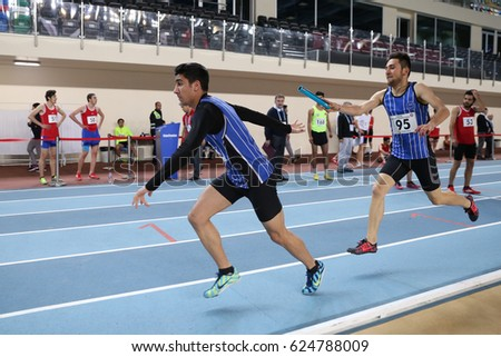 ISTANBUL, TURKEY - FEBRUARY 05, 2017: Athletes running 4x400 metres during Turkcell Turkish Youth Indoor Championships