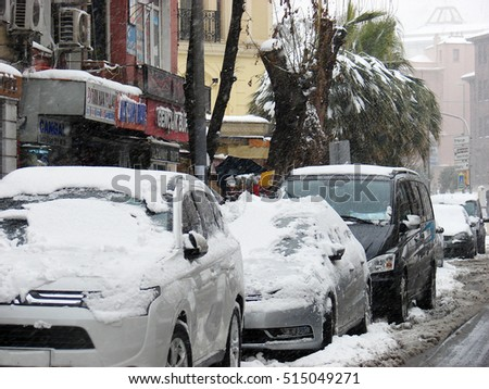 ISTANBUL, TURKEY - FEBRUARY,18,2015: cars covered with snow drifts in the center of Istanbul during a heavy snowfall