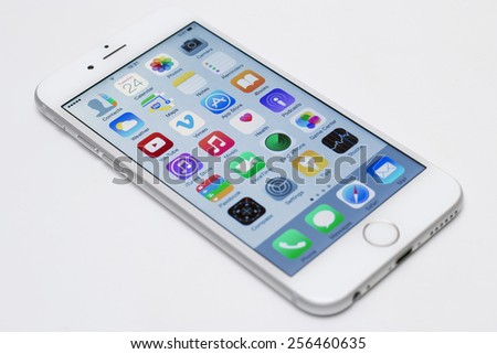 Istanbul, Turkey - February 26, 2015: iPhone 6 isolated on white background. Apple IPhone is one of the most popular smart phones in the world. - stock photo