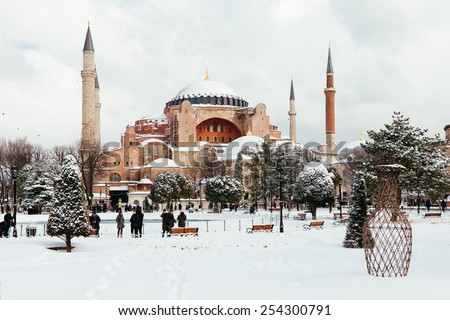 ISTANBUL, TURKEY - FEBRUARY 18, 2015:istanbul winter a day. St. Sophia Cathedral while snowing.People walking in Sultanahmet District under snow. - stock photo