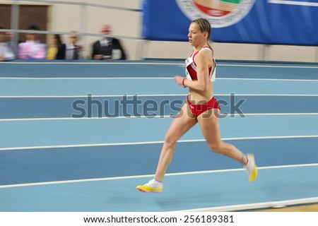 ISTANBUL, TURKEY - FEBRUARY 21, 2015: Montenegrin athlete Sladjana Perunovic running during Balkan Athletics Indoor Championships in Asli Cakir Alptekin Athletics hall. - stock photo