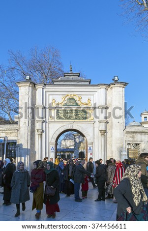 Istanbul, Turkey - February 7, 2016: People walking near The Eyup Sultan Mosque at the bright day on February 7, 2016 in Istanbul. Built in 1458, first mosque constructed by the Ottomans in the city.